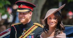 Prince Harry, in royal garb and hat, sits in a carriage with Meghan Markle who wears a matching pink dress and hat.