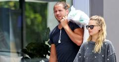 """*EXCLUSIVE* Margot Robbie and husband Tom Ackerley take their rescue dog """"Boo Radley"""" for a walk"""