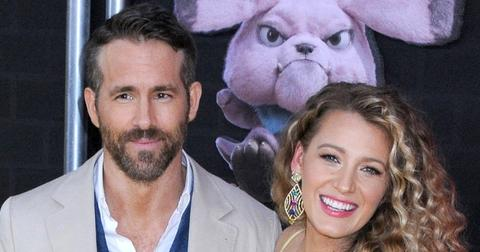 Ryan Reynolds Wearing a Suit With Blake Lively In a Yellow dress On a Red Carpet