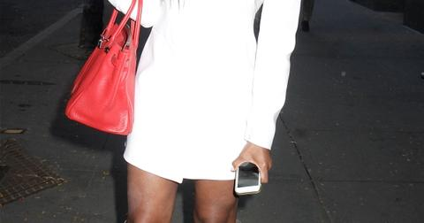 Wearing a white mini dress and grey suede boots, reality TV star Kenya Moore leaves 'Good Day New York'