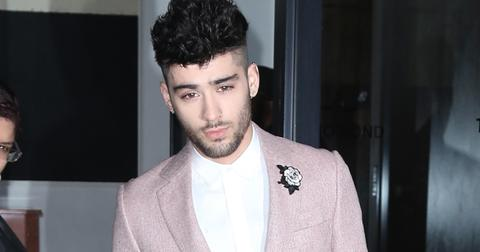 Zayn Malik heads to the Grammys sporting a white flower for #TimesUp