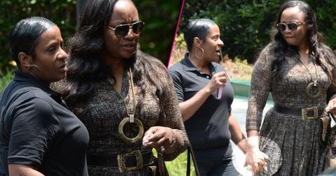 Pat houston tina brown hold hands outside hospice center