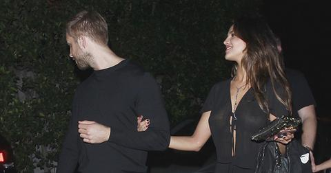 EXCLUSIVE: **PREMIUM EXCLUSIVE RATES APPLY** Calvin Harris is spotted in an arm in arm embrace with Eiza Gonzalez while leaving a party on Los Angeles.