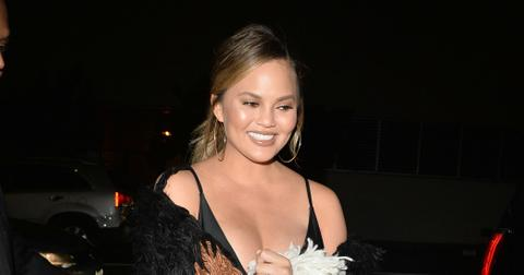 Chrissy Teigen Busty Chest Revolve Launch Party Photos hero22