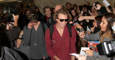 5 Seconds of Summer are mobbed by hundreds of girls as they arrive in Los Angeles