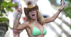 Ramona Singer looks very happy dancing on the boardwalk in Miami Beach
