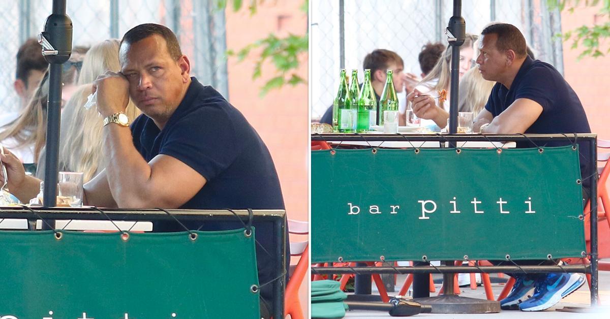 alex rodriguez looks sad as he eats alone in bar pitti