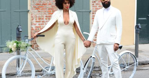 Solange Knowles and Alan Ferguson ride bikes wearing white on their wedding day