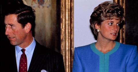 Prince Charles and Princess Diana looking in opposite directions of each other.