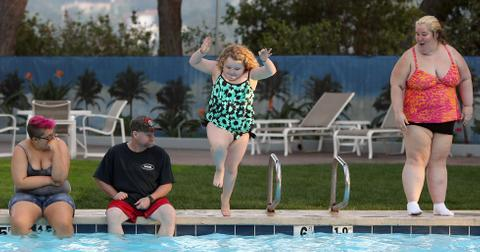 EXCLUSIVE: **PREMIUM RATES APPLY** Mama June makes a big splash in Hollywood as the 'Here Comes Honey Boo Boo' clan hit their hotel pool