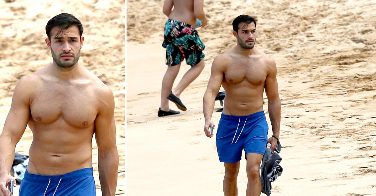 britney spears boyfriend sam asghari takes a solo stroll on the beach while on vacation in maui ok