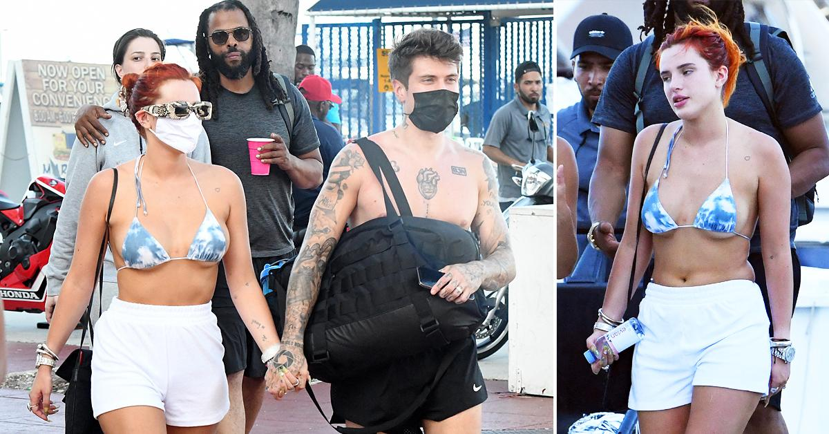 bella thorne wears a blue and white bikini as she holds hands with fiance benjamin mascolo while getting off a yacht