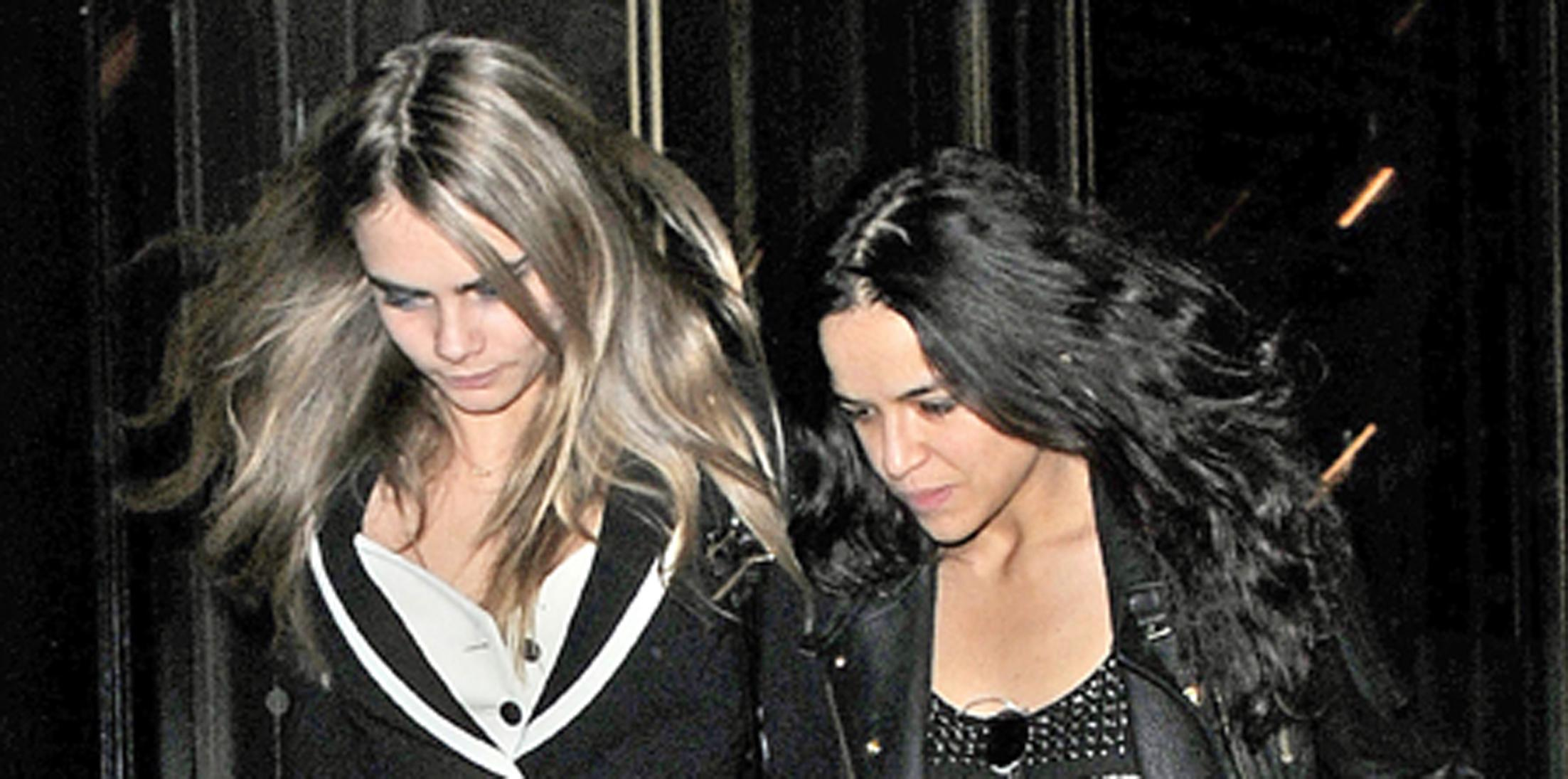 Cara Delevingne and Michelle Rodriguez leaving a restaurant after a date night **USA ONLY**