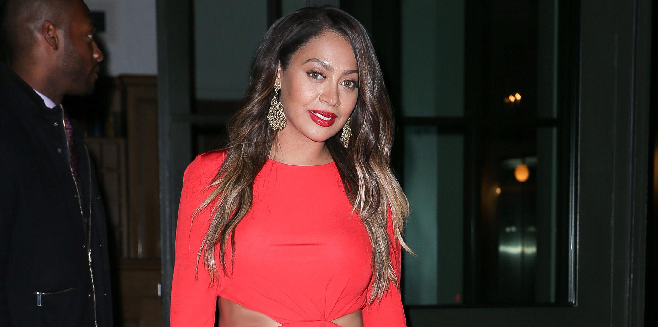 La La Anthony struts in a red dress exiting her hotel in SoHo
