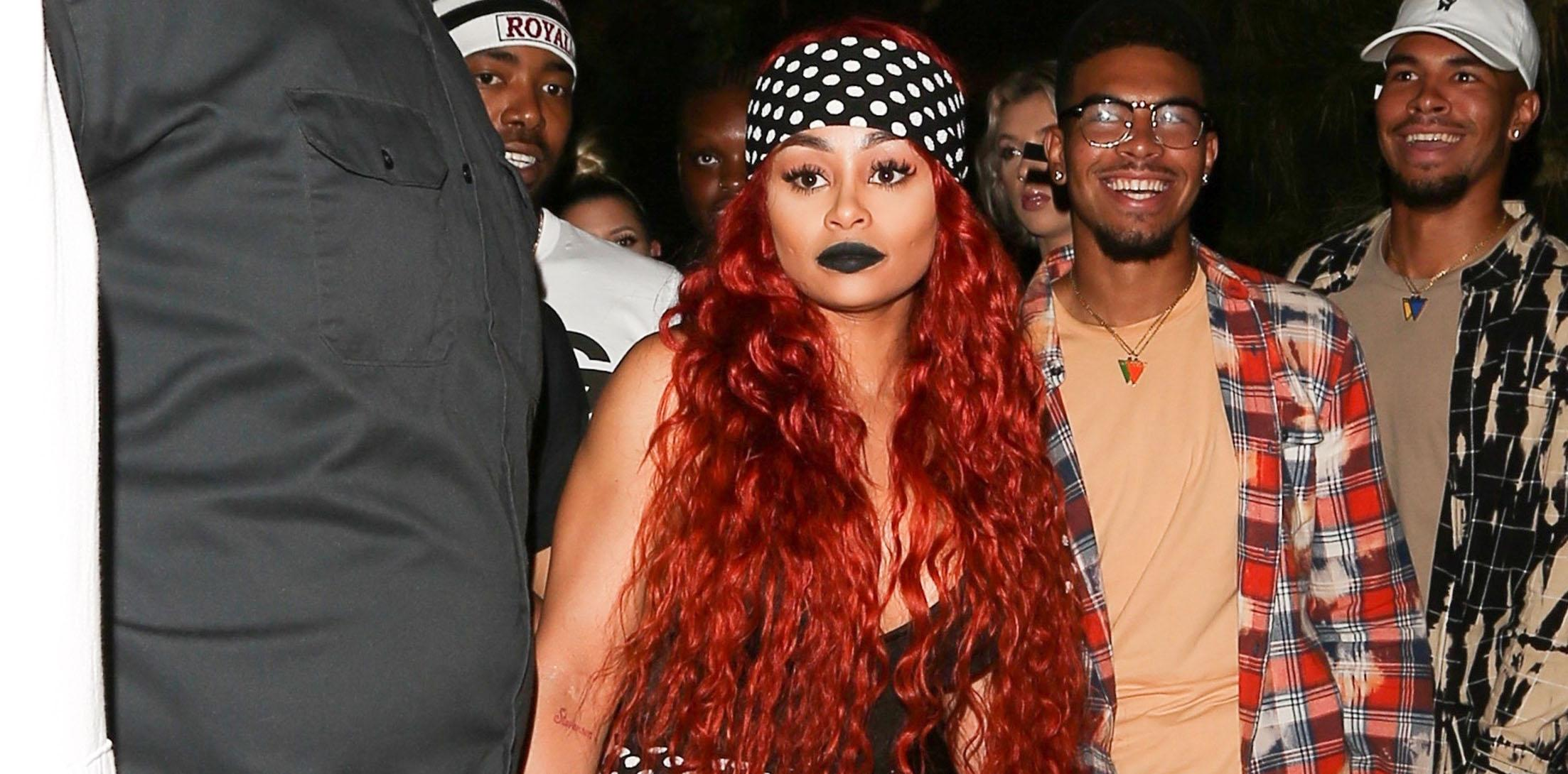 Blac Chyna is hard to miss in all polka dots as she sports red hair