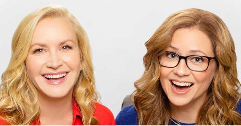 Angela Kinsey wore a collared red blouse while podcast co-host Jenna Fischer sported a blue sweater with a gold necklace.