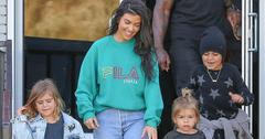 Kourtney Kardashian grins from ear to ear as she leaves the bowling alley with her family