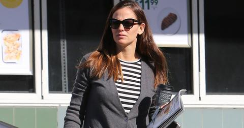 Jennifer Garner picks up a magazine while running errands
