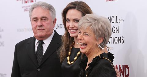 Angelina Jolie walks Brad Pitt's parents down the red carpet at the Premiere of In the Land of Blood & Honey in NYC
