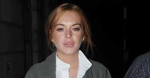 INF – Lindsay Lohan Wears A Long Coat Over A White Dress & Knee High Boots