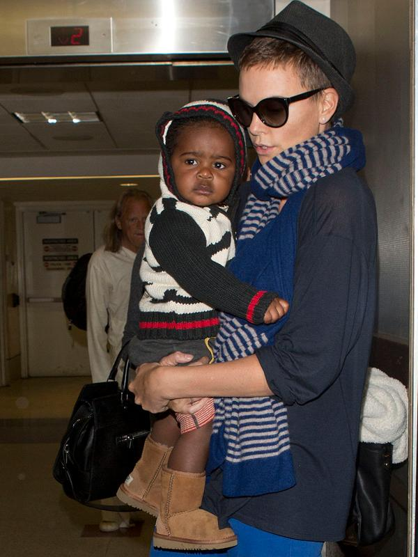 Charlize Theron and her baby Jackson seen arriving at LAX on a flight from Miami