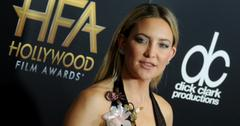 Kate Hudson wears a black dress with plunglng neckline and flower accents at the 2016 Hollywood Film Awards.