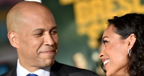 Corey Booker smiles at Rosario Dawon on the red carpet - and she smiles back.