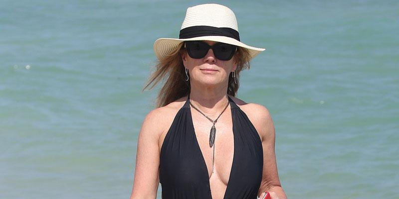 Ramona Singer struts on a beach in Miami
