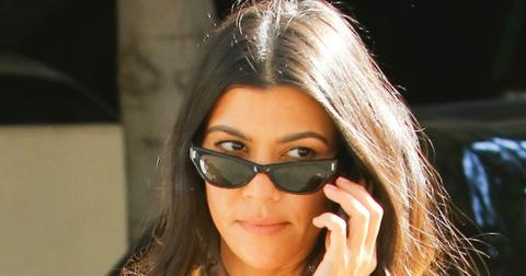 Kourtney Kardashian Wears Yellow Charge It 2 Da Game T Shirt Photos hero