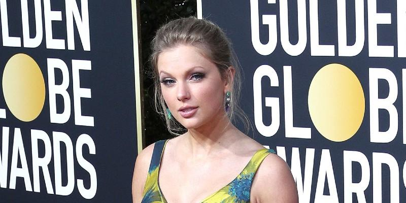 Taylor Swift Wearing A Blue and Yellow Dress