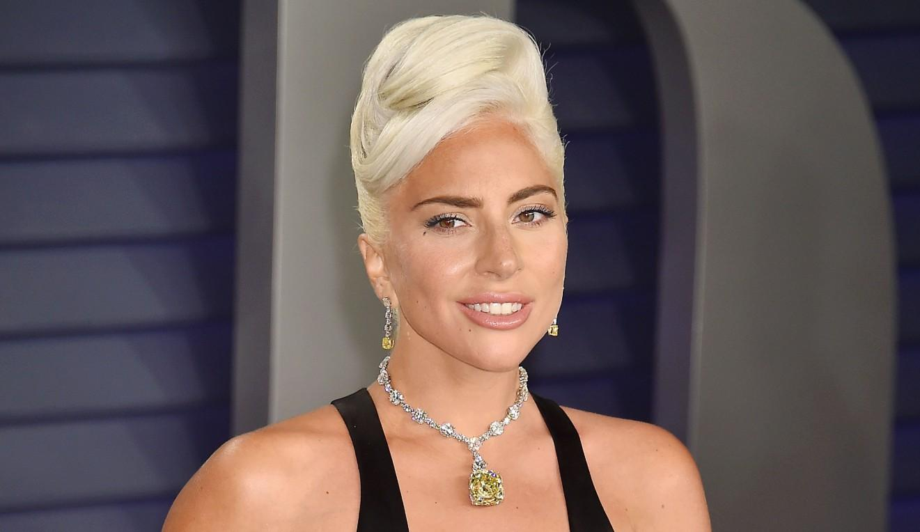 Lady Gaga Wears a Black Dress With an Oscar