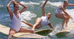 suicide squad margot robbie wipes out surfing sexy white one piece bathing suit
