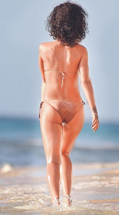 Singer Rihanna is pictured at the beach while on holiday in Barbados