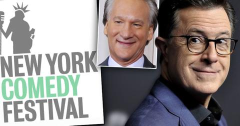 New York Comedy Festival Logo, Stephen Colbert Wearing Eye Glasses, Black Shirt and Blue Blazer Inset Bill Mahr Smiling Wearing White SHirt